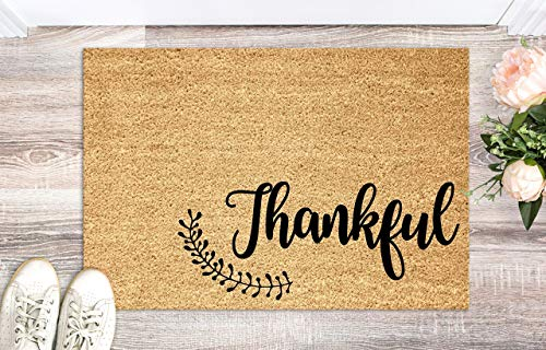 3. A fall-inspired door mat to welcome guests.