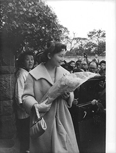 Vintage photo of Crown Princess Michiko smiling at the crowd while carrying a bouquet of flowers.Born Michiko ShÅda on 20 October 1934, is the Empress consort of Japan as the wife of Emperor Akihito, the current Emperor of Japan reigning from 7 January 1989.