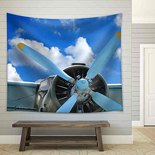 Old Biplane Against Blue Sky Vintage Background Close Up Fabric Wall Tapestry