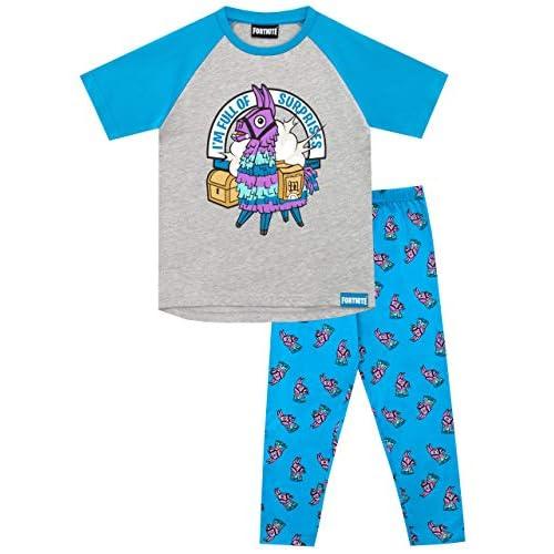 """51RWebNeWLL. SS500 Pijama para niños de Fortnite. Este épico conjunto de pijama de Battle Royale viene con un gran estampado de la llama púrpura del videojuego en el top, con el eslogan """"I'm Full Of Surprises"""". Parte superior: 93% Algodón 7% Poliéster Parte inferior: 100% Algodón"""