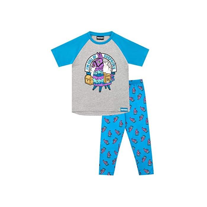 """51RWebNeWLL Pijama para niños de Fortnite. Este épico conjunto de pijama de Battle Royale viene con un gran estampado de la llama púrpura del videojuego en el top, con el eslogan """"I'm Full Of Surprises"""". Parte superior: 93% Algodón 7% Poliéster Parte inferior: 100% Algodón"""