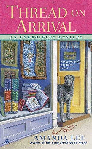 Thread on Arrival: An Embroidery Mystery ()