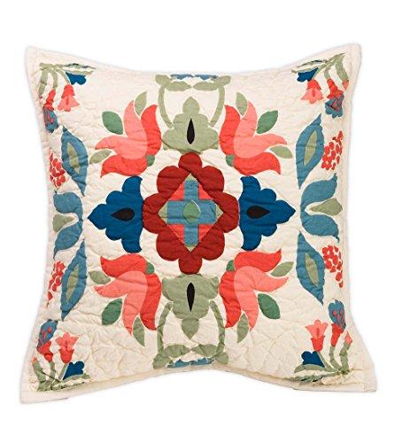 Ansley Folk Art Throw Pillow in Cream