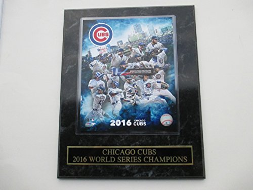(2016 CHICAGO CUBS PLAYERS ACTION PHOTO & GOLD AND BLACK WORLD SERIES CHAMPIONS NAMEPLATE MOUNTED ON A 12' X 15' BLACK MARBLE PLAQUE)