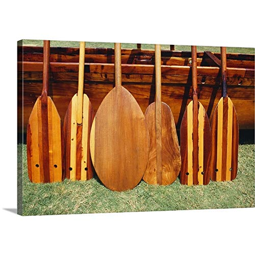 (Hawaii, Different Shaped Canoe Paddles in Front of Koa Canoe Canvas Wall Art Print, 36