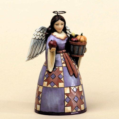 (Jim Shore for Enesco Heartwood Creek Pint Sized Harvest Angel Figurine, 5.2-Inch)