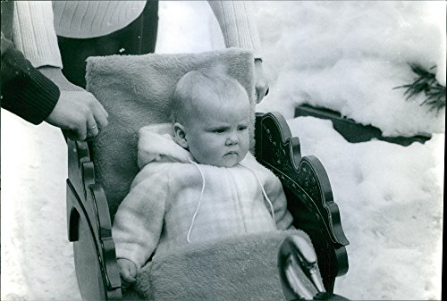 Vintage photo of Princess Beatrix and Prince Claus of the Netherlands first son Prince Willem Alexander is sitting in a sleigh during their family vacation one winter season.