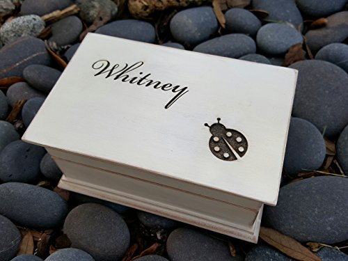 Custom engraved wooden musical jewelry box with the name of your choice on top and a ladybug image, perfect gift for new babies or birthdays