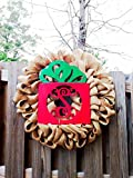 This wreath will make a great addition to your Christmas decorations. This is a red burlap wreath with an 18 inch Christmas monogram present painted with red and green quality paint. This wreath is featured on an 18 inch wire form and once co...
