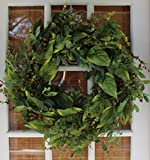 Faux green foliage and silks intertwine with green berries to make this versatile decorative outdoor wreath a favorite. This is a year round front door wreath that adds a touch of green to any home or decor. Measures 22-24 inches diagonally a...