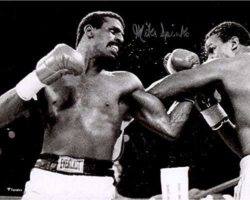 "Michael Spinks Autographed 8"" x 10"" Punching Larry Holmes Photograph - Fanatics Authentic Certified - Autographed..."