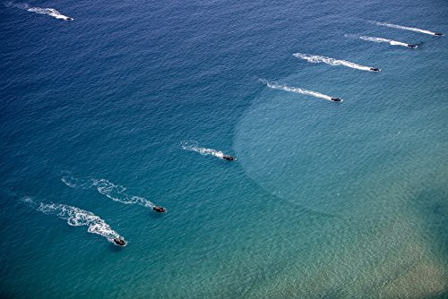 US Marine amphibious assault vehicles practice a beach assault in Busan South Korea Poster Print by Stocktrek Images (17 x 11)