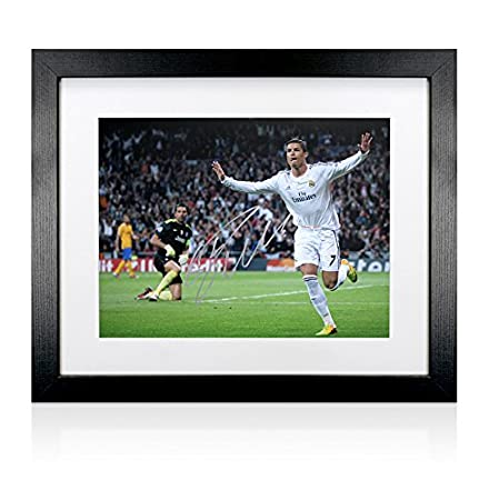 644871d88b5 Framed Cristiano Ronaldo Hand Signed Real Madrid Print - Scoring Against  Juventus  Amazon.co.uk  Kitchen   Home