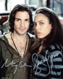 SANTIAGO CABRERA and TAWNY CYPRESS as Isaac Mendez and Simone Deveaux