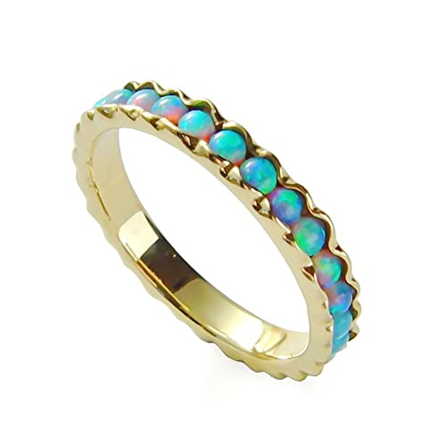 Amazoncom Gold Opal infinity ring Blue stones ring Wedding band