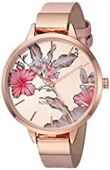 Welcome spring and summer into your accessory collection with this floral rose goldtone watch by Nine West. Backed by a petite blush strap, it's simple yet sophisticated and features coordinating rose goldtone hands and markers. A straightfor...