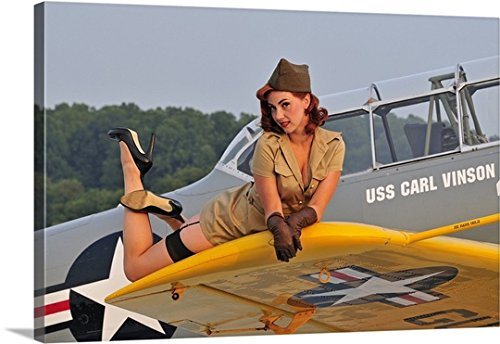 Christian Kieffer Gallery-Wrapped Canvas entitled 1940's style pin-up girl lying on a T-6 Texan training aircraft by greatBIGcanvas