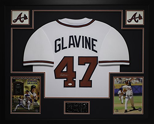 Tom Glavine Autographed White Braves Jersey - Beautifully Matted and Framed - Hand Signed By Tom Glavine and Certified Authentic by JSA - Includes Certificate of Authenticity