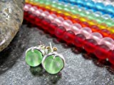 Choose from 10 colors! Tiny sea glass stud earrings perfect for the beach, everyday and gift giving. They feature pretty 6mm sea glass beads wire-wrapped in sterling silver and are finished with sterling silver ear nuts. The finished earrings...