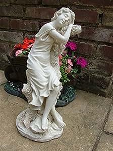Sentado en un árbol estatua de chica. 42,55 cm alto. Hecho de piedra y poliresina