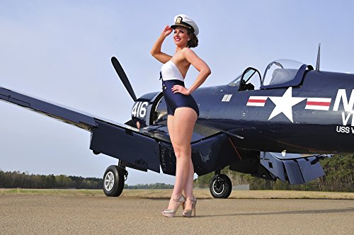 Posterazzi Beautiful 1940's style Navy pin-up girl posing with a vintage Corsair aircraft Poster Print (8 x 10)]()