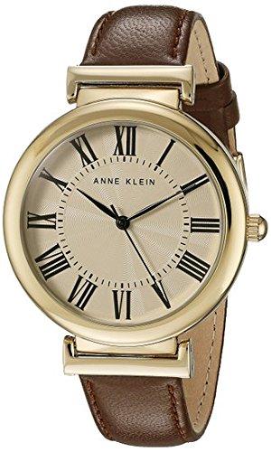 Anne Klein para mujer reloj infantil de cuarzo con esfera analógica blanca y correa de piel color marrón AK/n2136crbn