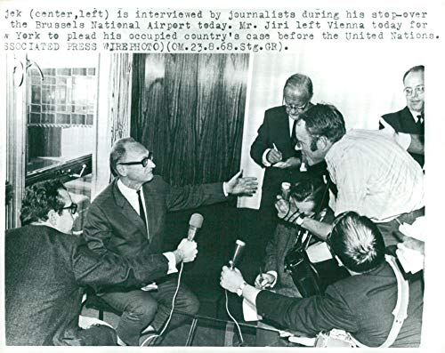 Vintage photo of Czechoslovak politician JiÅ237; H225;jek is interviewed at Brussels National Airport