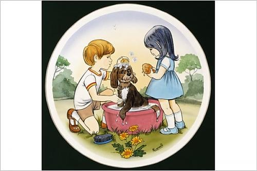 Photographic Print of A boy and a girl wash their pet dog
