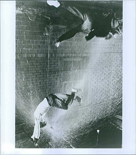 """Over the hill photo of A scene from the film """"Rumble Fish"""" casting by Glenn Withrow and Matt Dillon."""