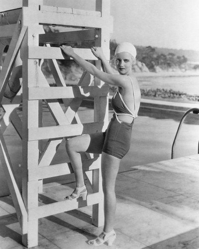 - Bette Davis full length 1930's pose in swimsuit by pool 16x20 Poster