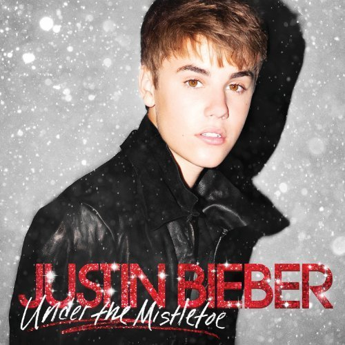 Under The Mistletoe [CD/DVD Combo] [Deluxe Edition] by Justin Bieber (2011) Audio CD