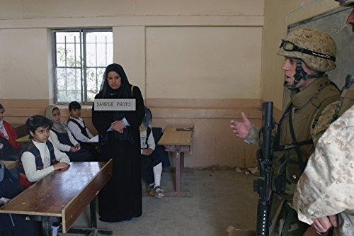 Photo U.S. Marine Corps CAPT. Christopher Perkins with the 2nd Battalion, 5th Marines, talks to Iraqi girls before distributing school supplies near the town of Ar Ramadi, Iraq during Operation Al Fajr, in support of Operation IRAQI FREEDOM on Dec. 11, 2004, 12/11/2004
