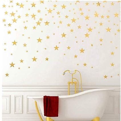 Amazon.com: Adhesivo de pared con estrellas doradas.: Toys ...