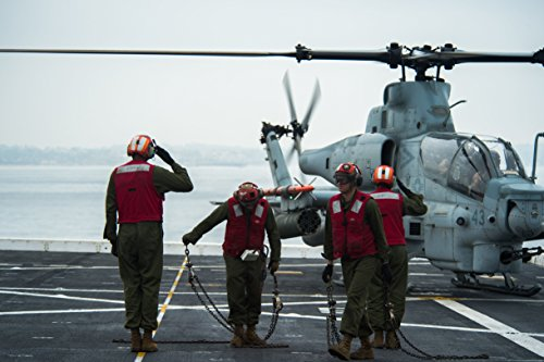 Marines assigned to the Greyhawks of Marine Medium-lift Tiltrotor Squadron (VMM) 161 (REIN) prepa
