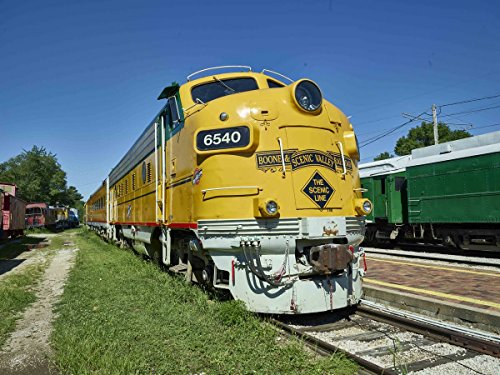 Run Diesel Locomotive - Photo | BSVY #6540, a former Canadian National Railway GMD FP9 diesel locomotive with CNW markings, waits its turn for a run in the yards of the Boone & Scenic Valley Railroad, a herit 3 14in x 11in