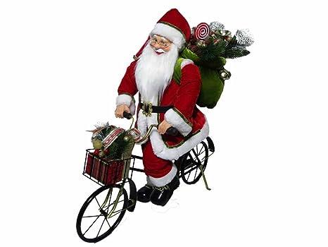 Foto babbo natale in bici
