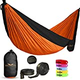 """Made of light yet tough parachute nylon, our double hammock measures 118"""" long x 78"""" wide & holds 2 people (up to 400 lbs.). Folds down into its own compact pouch for easy toting. Includes 2 bonuses Whether you're hiking the backcountry or loungi..."""