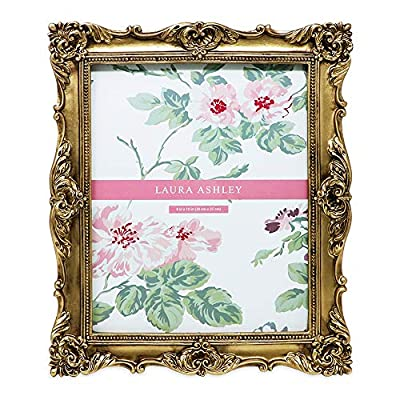 Laura Ashley 8x10 Gold Ornate Textured Hand-Crafted Resin Picture Frame with Easel & Hook for Tabletop & Wall Display… - BRING PHOTOS TO LIFE: Frames aren't just for displaying your photographs-- they serve as home decor too! The elegant, molded photo frame surrounds your precious memories in a pretty frame that also serves as room decor. This Laura Ashley frame draws attention to your favorite photos while adding glamour, finesse, and literal and figurative color to any room. The beautiful floral design lining this photo frame wrap your picture in a truly resplendent fashion, bringing extra charm to your home VERSATILE & EASY TO USE: This decorative baroque style picture frame can be placed just about anywhere, from your home to your office, and can even complement your bathroom. It fits neatly on the edge of a desk as well as atop an end table or shelf. Easy-twist tabs secure your photo in place, while a clear glass pane keeps your special memories in this elegant photo frame. Prefer to hang it on the wall? Use the built-in hooks to mount it to the wall with ease (mounting hardware not included) PORTRAIT OR LANDSCAPE: The backside of this frame has a graceful and soft black velvet fabric and comes with a 2-way easel that supports and positions this attractive frame in either vertical or horizontal orientation. Use the kickstand to prevent the frame from tipping over in either direction. With the versatility that the easel provides, you can rotate the frame for any picture your heart desires to stand out in your bedroom, kitchen, den etc. - picture-frames, bedroom-decor, bedroom - 51St8Xsgy3L. SS400  -