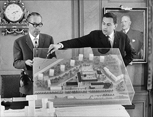Center Finished (Vintage photo of Municipal Board chairman and city architect showing off the finished model of Tumba center. A number of people were invited to see the plans.)