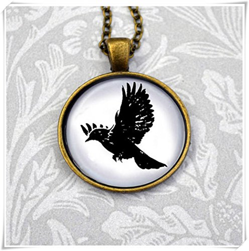 Magical magnet Blackbird bold graphic stamp style illustration in round antique bronze pendant necklace ()
