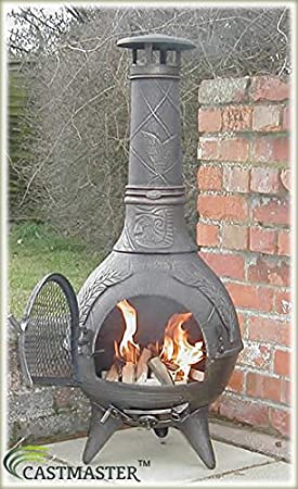 Chimenea de hierro fundido Castmaster Calico con parrilla para barbacoa incluida, acabado en color bronce