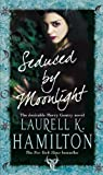 Front cover for the book Seduced by Moonlight by Laurell K. Hamilton