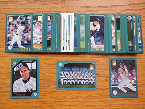 New York Yankees 2001 Topps Baseball Master Team Set (with Series 1, 2 and Year-End Traded Cards) (57 Cards) (American League Champions) **Erick Almonte, Clay Bellinger, Danny Borrell, Jose Canseco, Roger Clemens, Michael Coleman, David Cone, Bucky Dent Golden Moments, Jason Grimsley, Rickey Henderson 1985 Topps Traded Reprint, Adrian Hernandez, Orlando Hernandez, Glenallen Hill, Reggie Jackson Golden Moments, Derek Jeter, Nick Johnson, David Justice, Chuck Knoblauch, Don Larsen Golden Moments