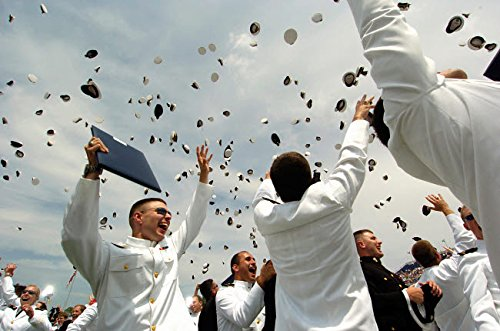 Newly commissioned US Naval Officers celebrate by throwing their hats in the air Poster Print by Stocktrek Images (34 x 22)