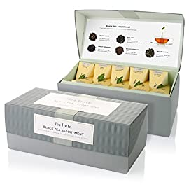 Tea Forte Black Tea Assortment Presentation Box Tea Sampler, Assorted Variety Tea Box, 20 Handcrafted Pyramid Tea Infuser Bags 86 BLACK TEA ASSORTMENT with five varieties of our most popular black tea blends - Earl Grey, English Breakfast, Estate Darjeeling, Black Currant, Orchid Vanilla DIVERSE, SUBTLE FLAVORS from only the finest whole tea leaves in the world, blended with aromatic fruits, flowers and herbs DELIGHTFUL TEA GIFT SET offers a variety of premium gourmet teas, a most welcomed hostess gift or gift for tea lovers