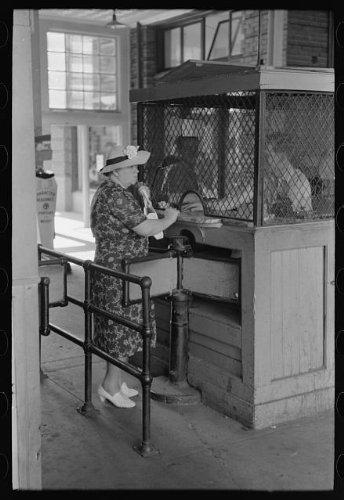 Photo: Woman buying ticket at gate. Streetcar terminal, Oklahoma City, Oklahoma 1 . Size: 8x10 - Melbourne Terminal 1