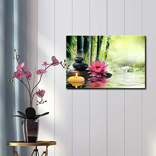 Rocks and a Pink Flower on a Lake Next to Bamboo Branches