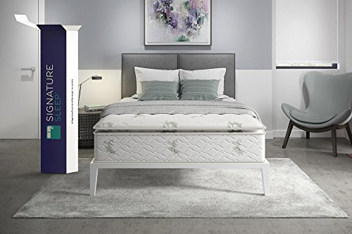 Signature Sleep Mattress with packaging box laid on a bed with headboard and lazy chair