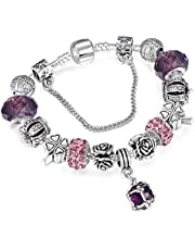 A 925 silver bracelet adorned with Pandora elements, beads, roses and a silver crown with a pendants shaped like a crystal ball