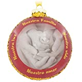 "This pretty ornament celebrating family features gold glitter and a sweet image of a child's hand being held lovingly by an adult hand. Spanish messages says ""Nuestra Familia…Nuestra Vida…Nuestro Amor…Nuestra Luz"" in gold lettering. Hallmark ..."